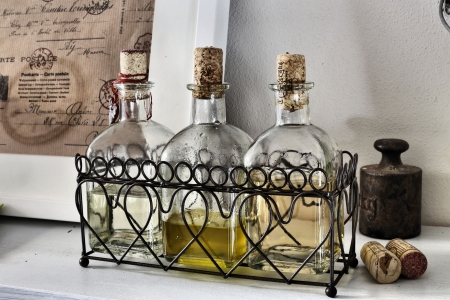 spices in bottles with cork - oil, vinegar, wine- old style photo