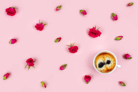 Pink background with a Cup of coffee surrounded by flowers. Flat lay, top view. Imagens