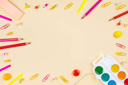 Back to school creative template with pencils, clips and watercolor. Composition in red and yellow colors. Stok Fotoğraf