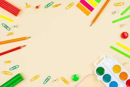 Back to school creative template with pencils, clips and watercolor. Composition in green and red colors. Stok Fotoğraf