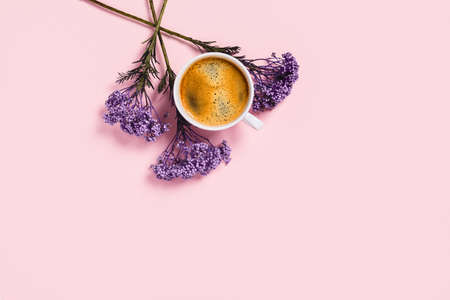 White cup of coffee and flowers on isolated pink desk. Flat lay, top view, copy space. Archivio Fotografico - 133553793