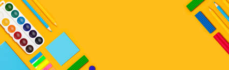School supplies on yellow vertical background. Back to school web-banner. Banque d'images - 142465991