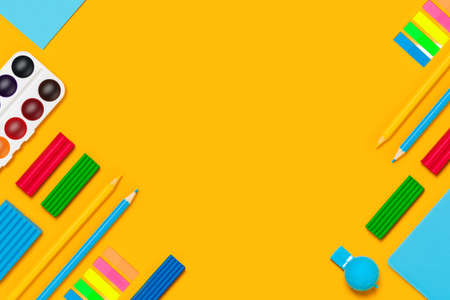 School supplies on yellow background. Back to school picture.