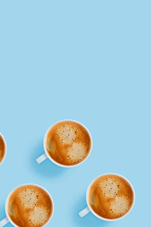 Morning cups of strong coffee on blue background.