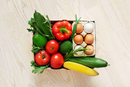Fresh vegetables in a cardboard box. Fast delivery right from the store.