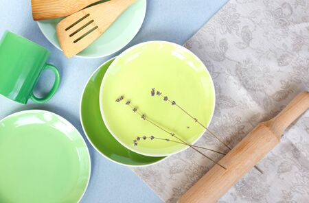 green plates on a linen tablecloth whith lavender brunch Stock Photo