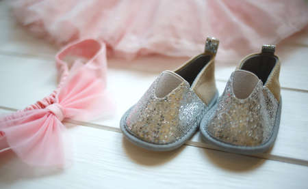 Outfit for a little girl: booties, bow and tulle skirt.