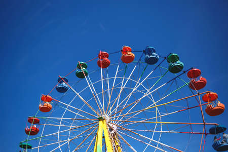 carousel ferris wheel on blue sky background.