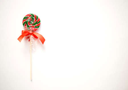 bright sweet christmas lollipop on white background.