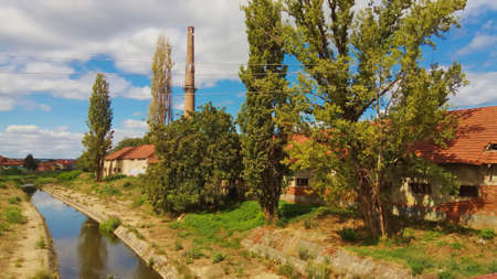 Old ruined factory by river bank