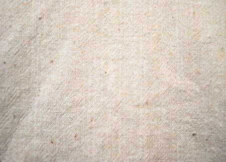 cotton fabric: Crumpled light beige cotton fabric texture. Background Stock Photo