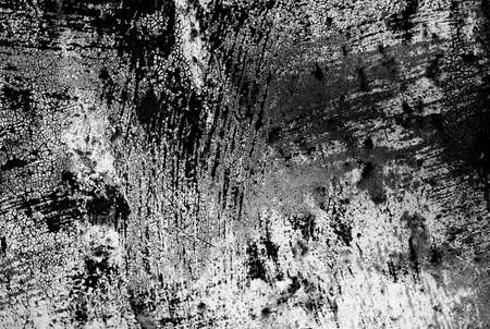 crackles: Rusty metal surface with black paint spots
