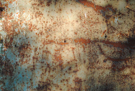 crackles: Rusty metal surface with patches of sunlight