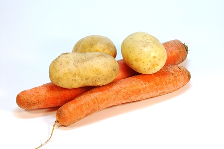 Two clean carrots with three small potatoes Stock Photo - 10619119