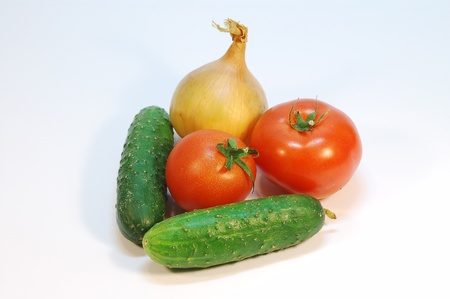 An onion, couple of tomatos and cucumbers