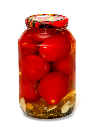 Marinated tomatos in the glass jar