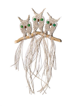 Three little owls woven out of cords and ropes using the art of macrame