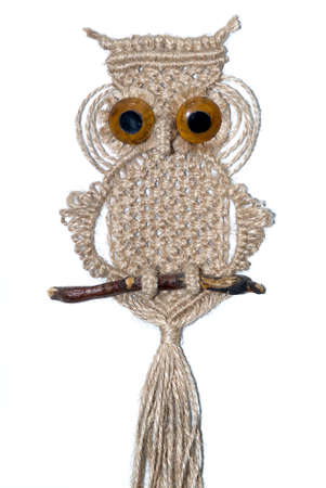 An owl woven out of cords and ropes using the art of macrame photo
