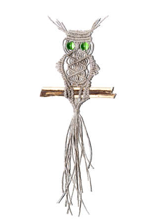 An owl woven out of cords and ropes using the art of macrame
