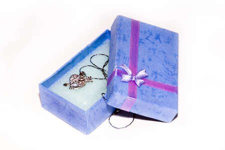 A box with silver present isolated on a white background