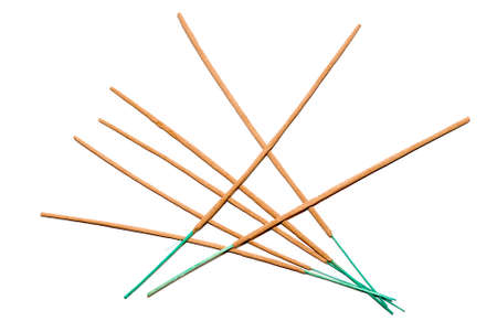 Seven incense sticks isolated on a white background