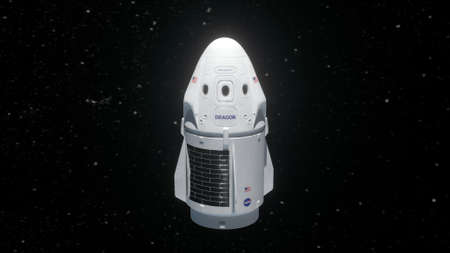 New york, USA - May 31, 2020: Crew dragon cargo spacecraft in earth orbit. Spacex