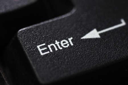 Closeup of a black keyboard button Enter