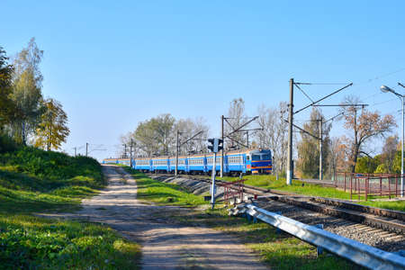 Electric train travels to the train station for boarding passengers in Russia.