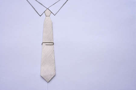 Paper tie with clip, white shirt and office manager suit, copy space 版權商用圖片