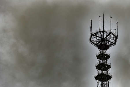 Meteorological antenna at station measures the weather during a storm