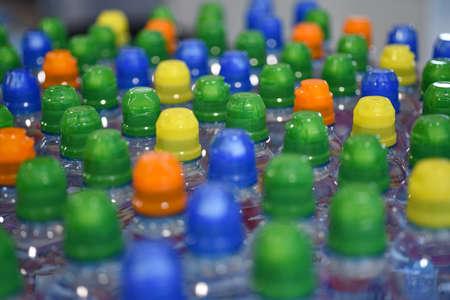 Colored plastic drinking water bottles for children. Zdjęcie Seryjne
