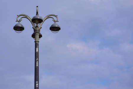 City lamp post on sky background. Zdjęcie Seryjne