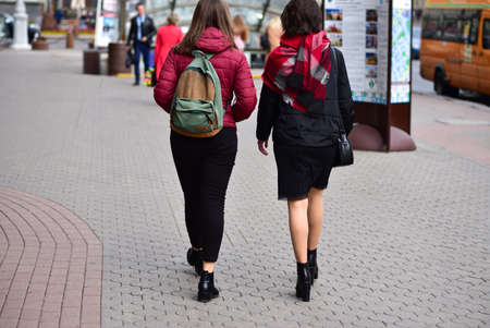 Young girls walk in the city of Minsk.