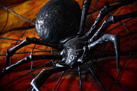 Scary iron spider crawls on a wall with blood. Zdjęcie Seryjne