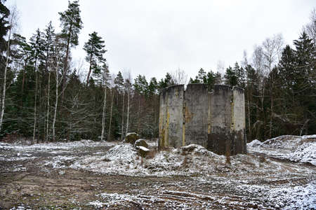 Old abandoned stationary Soviet nuclear missile launcher in the forest.