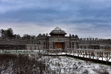 Old medieval wooden fortress in winter. Фото со стока - 138039379