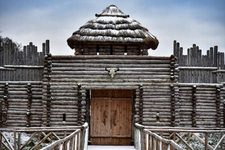 Old medieval wooden fortress in winter.