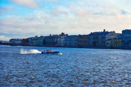 Pleasure boat with tourists sailing along the Neva River in Saint Petersburg. Фото со стока