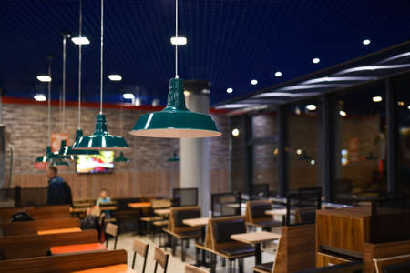 Evening interior of fast food cafe. Фото со стока - 138196479