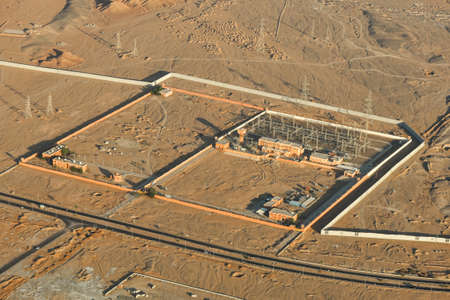 Power plant in the desert among the sands, top view.