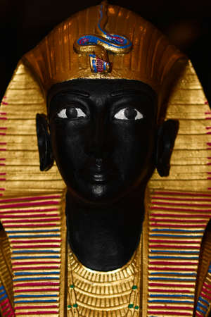 The old head of the Egyptian sculpture of the pharaoh.
