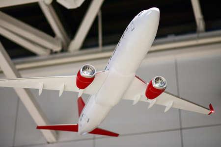 A model of a passenger plane hanging under the roof. 免版税图像