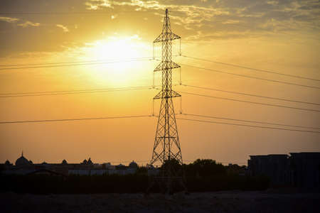 High voltage power line at sunset in an arab country.