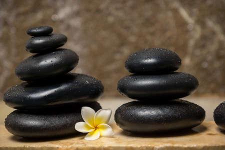 Beautiful setup: stones and frangipani flower on marble