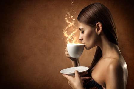 woman drinking tea: Coffee magic Stock Photo