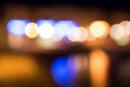 City lights at the night. Blurred bokeh background Standard-Bild