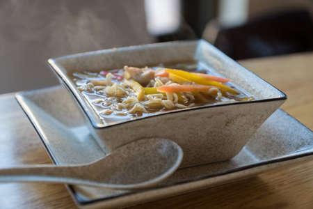 Japanese cuisine. Noodle soup in a big square bowl