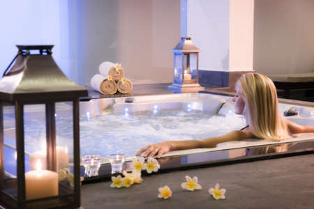 spa candles: Spa theme .The girl relaxes in a jacuzzi