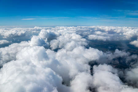 Nice view of the sky with fluffy clouds from the airplane