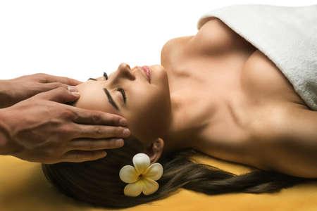 Beautiful young girl has a facial massage.